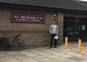 Mohamed in front of St Benedict's church