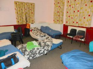 beds set up in church hall