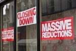 Shop front with poster saying it is closing down