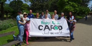 group of people in front of CAFOD banner