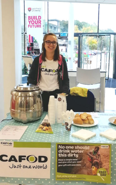 student behind CAFOD stall