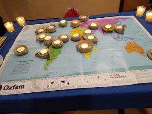 tea lights arranged on a world map