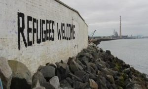 refugees welcome graffitti